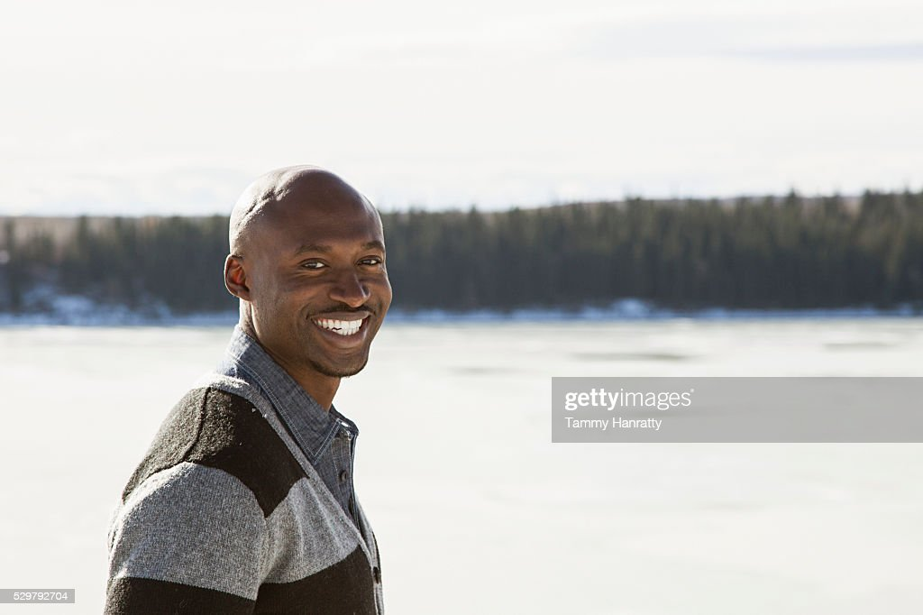 Portrait of mid-adult man on snow : Stock Photo