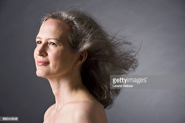 portrait of mid-aged woman hair blowing