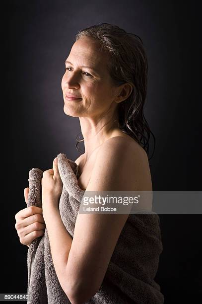 portrait of mid-aged woman wrapped in a towel