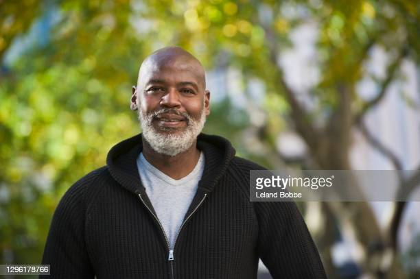 portrait of middle aged african american man - one mature man only stock pictures, royalty-free photos & images
