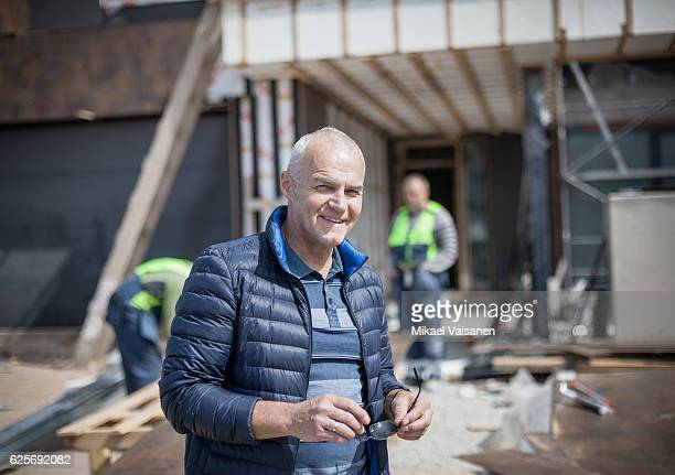 Portrait of middle aged architect at residential construction site