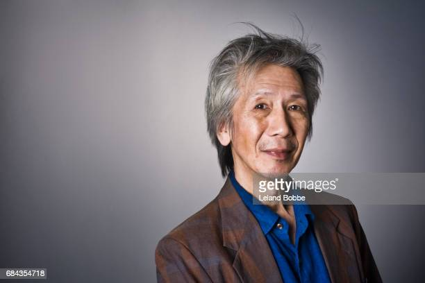Portrait of Middle Aged Asian Male with Grey Hair