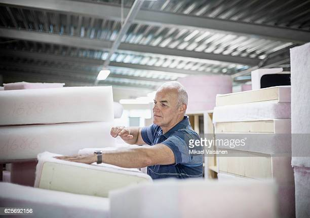 Portrait of middle aged entrepreneur in his furniture factory