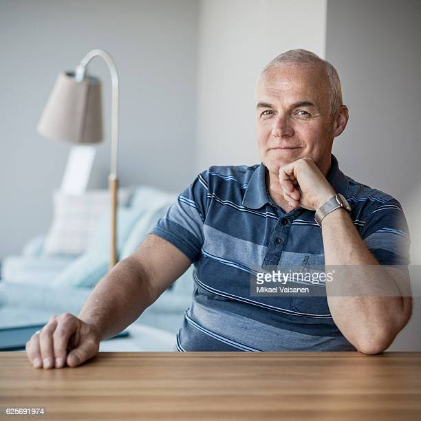 Portrait of middle aged entrepreneur in his furniture store