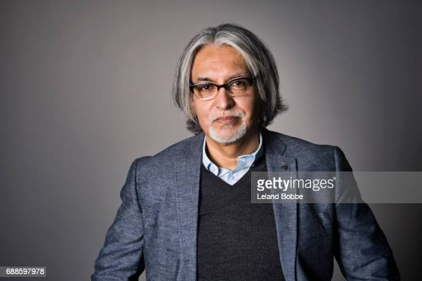 portrait of middle aged hispanic man with long  gray hair - gray blazer stock pictures, royalty-free photos & images