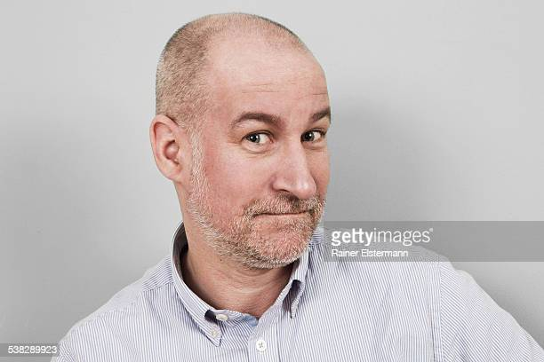 Portrait of middle aged man looking persuasive