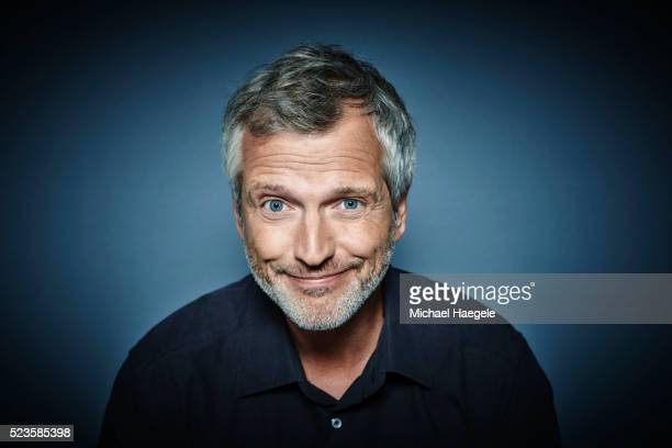 Portrait of middle aged man raising eyebrows