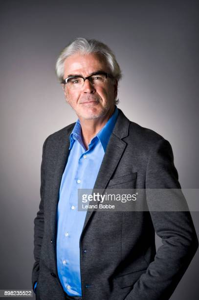 Portrait of Middle aged Man With Gray Hair Wearing Glasses
