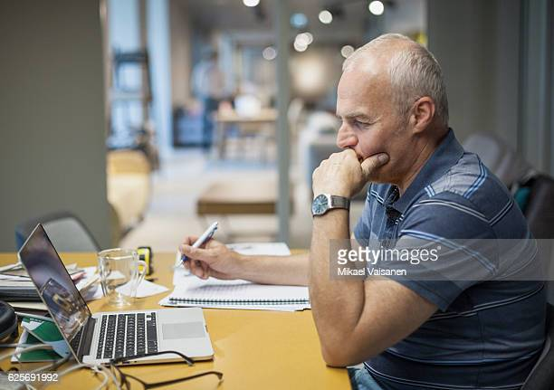 Portrait of middle aged man working in a furniture store