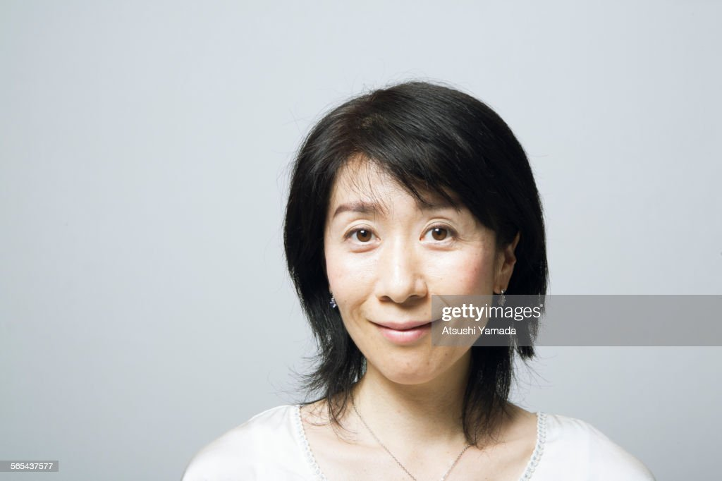 Portrait of middle aged woman,smiling : Stock Photo