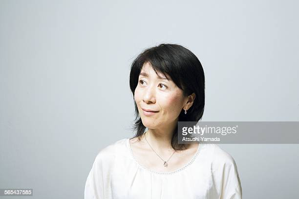 portrait of middle aged woman,smiling - blouse ストックフォトと画像