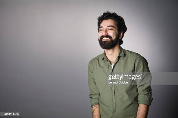 portrait of  middle eastern man with beard - looking away stock pictures, royalty-free photos & images