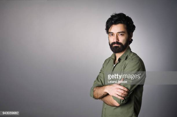 portrait of  middle eastern man with beard - arms crossed stock pictures, royalty-free photos & images