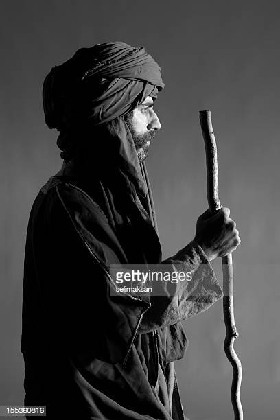 Portrait of middle eastern man with  headscarf in traditional clothing