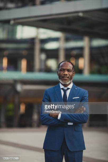 portrait of middle-aged african businessman - economist stock pictures, royalty-free photos & images
