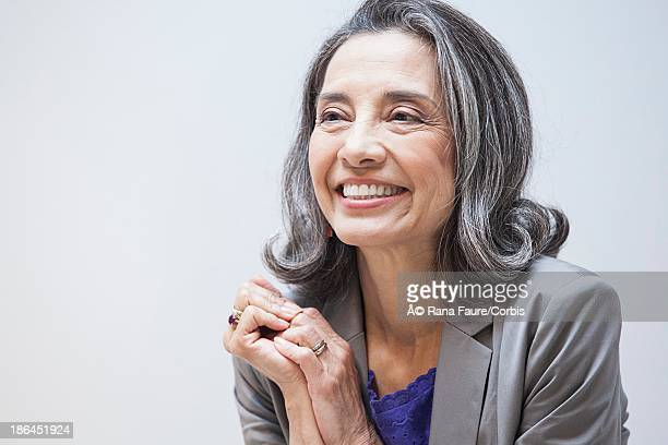 portrait of middle-aged businesswoman - looking away stock pictures, royalty-free photos & images
