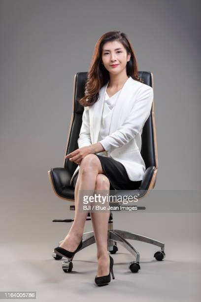 portrait of middle-aged chinese businesswoman - up skirts stock pictures, royalty-free photos & images