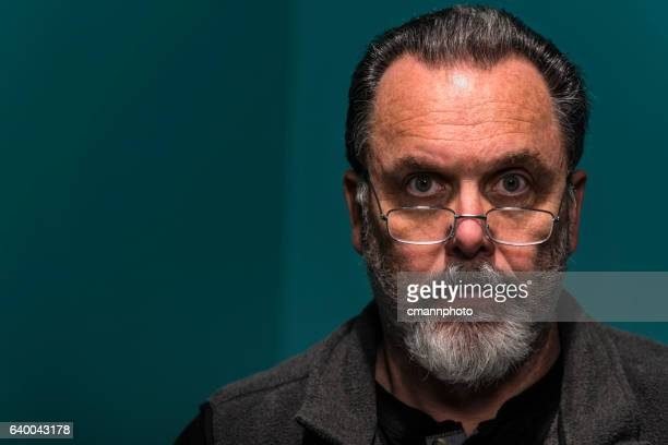 portrait of middle-aged man looking at camera contemplating life. - cmannphoto stock pictures, royalty-free photos & images