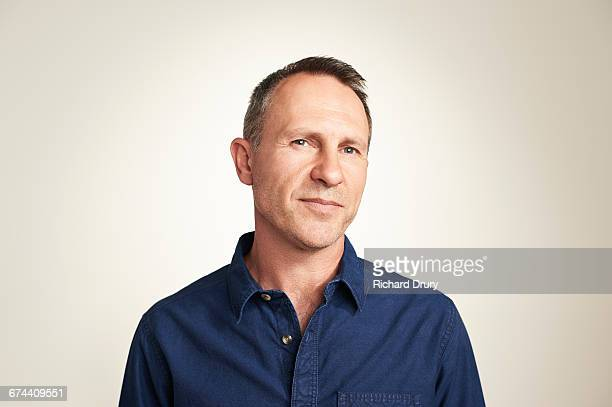 portrait of middle-aged man - expertise stock pictures, royalty-free photos & images