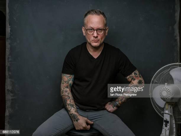 portrait of middle-aged man - top nero foto e immagini stock