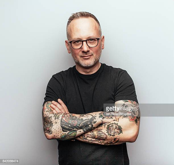 portrait of middle-aged man with arms crossed - tattoo stock pictures, royalty-free photos & images