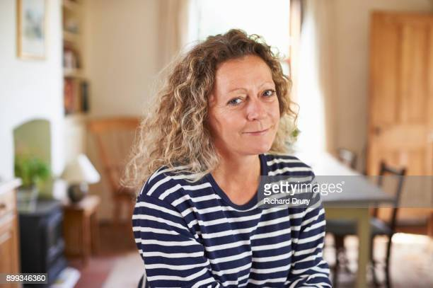 Portrait of middle-aged woman at home