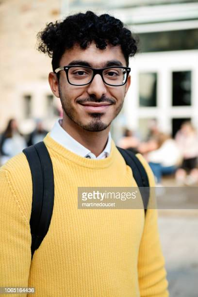 "portrait of middle-eastern ethnicity young adult man student in front of college. - ""martine doucet"" or martinedoucet stock pictures, royalty-free photos & images"