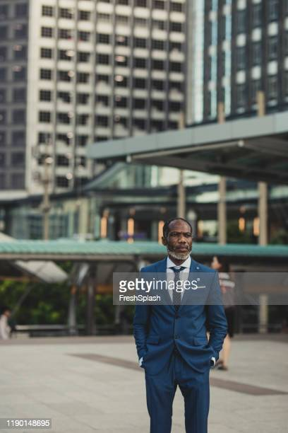 portrait of midlle-aged african businessman - economist stock pictures, royalty-free photos & images