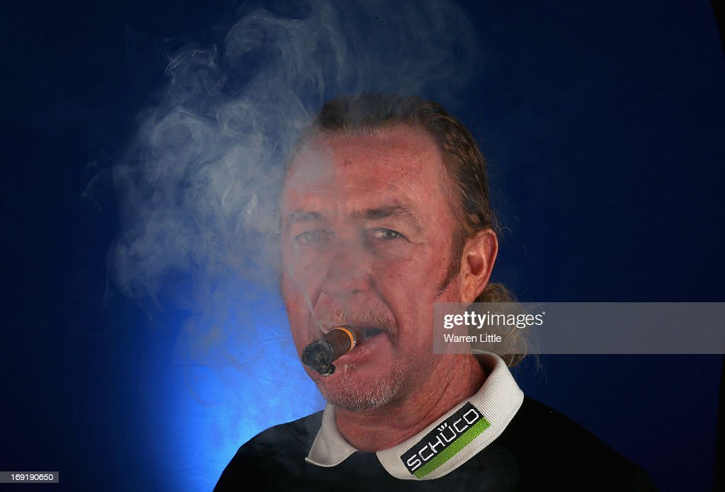 A portrait of Miguel Angel Jimenez of Spain ahead of the BMW PGA Championship at Wentworth on May 21, 2013 in Virginia Water, England.