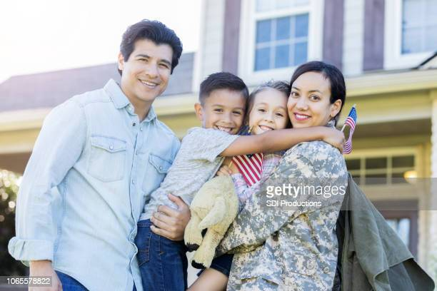 portrait of military mom and her family - military spouse stock pictures, royalty-free photos & images