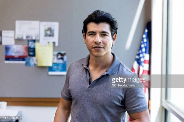 portrait of military veteran in front of american flag - handsome native american men stock pictures, royalty-free photos & images