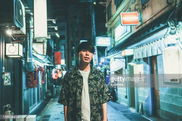 portrait of millennial asian male - tokyo japan stock pictures, royalty-free photos & images