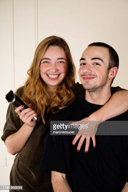 "portrait of millennial couple after shaving man's hair. - ""martine doucet"" or martinedoucet stock pictures, royalty-free photos & images"