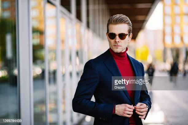 portrait of millennial handsome businessman during coronavirus lockdown, with sunglasses and blazer - blue blazer stock pictures, royalty-free photos & images