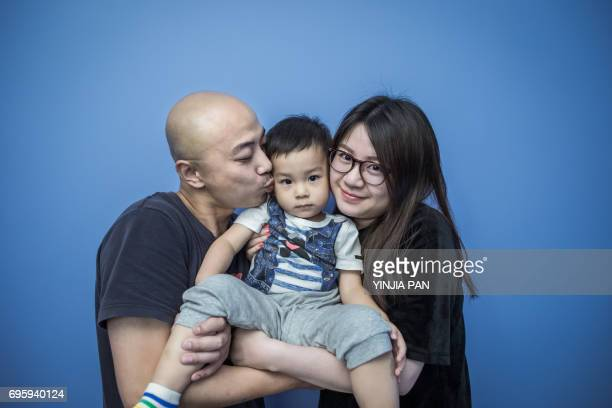 Portrait of Millennial Parents and their son