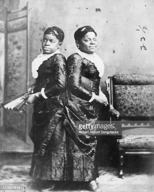 Portrait of Millie and Christine McKoy a pair of conjoined twins known as the 'Twoheaded Nightingale' Born in North Carolina to African slaves they...