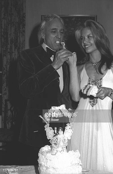 Portrait of millionaire businessman Huntington Hartford heir to the AP grocery chain and his new bride Elaine Kay as they taste the wedding cake at...