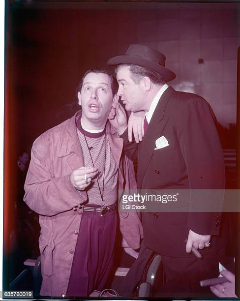 Portrait of Milton Berle and Lou Costello Berle is shown whispering into Costello's ear Undated photograph