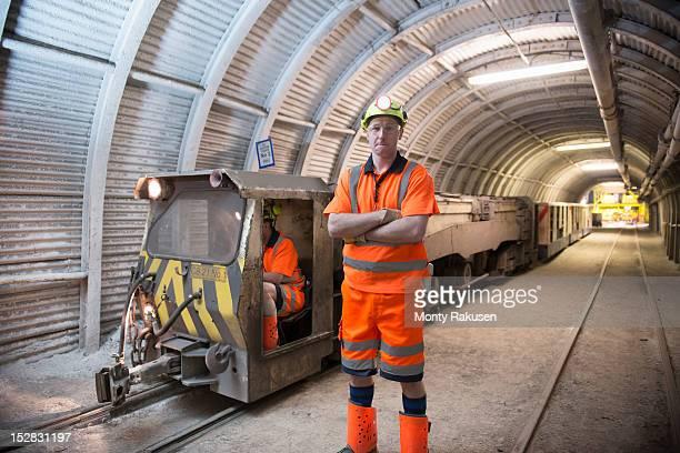 Portrait of miner in transport tunnel of deep coalmine