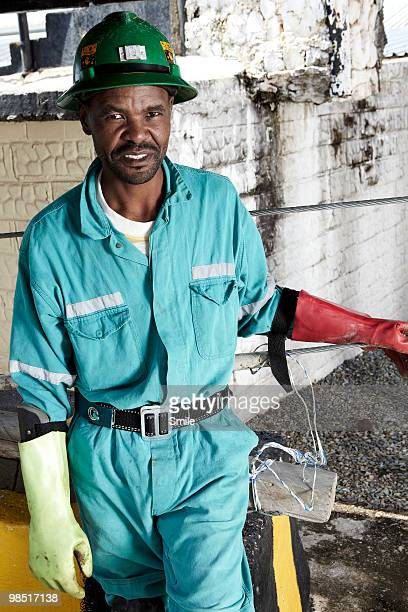 portrait of miner smiling - 鉱山労働者 ストックフォトと画像