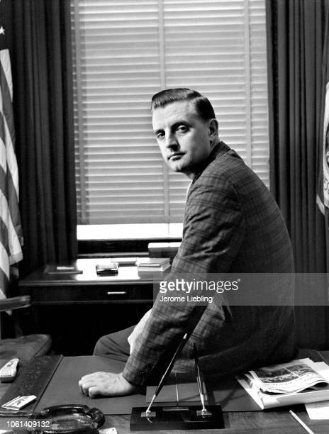 Portrait of Minnesota Attorney General Walter Mondale as he sit on a desk in his office at the State Capitol Building St Paul Minnesota July 1963
