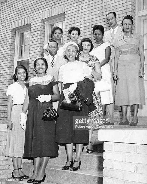 Portrait of 'Miss Chicago Defender' Susie Booker Goodloe as she poses contest runners-up Sarah Powell Hamilton and Marian Nathaniel and others, 1951....