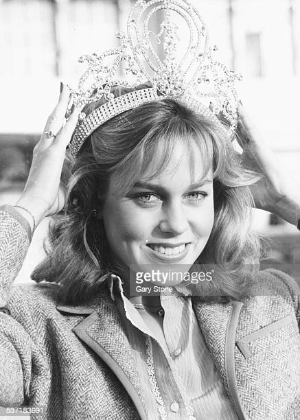 Portrait of Miss Universe American winner Shawn Weatherly placing her crown on her head during a visit to London December 19th 1980