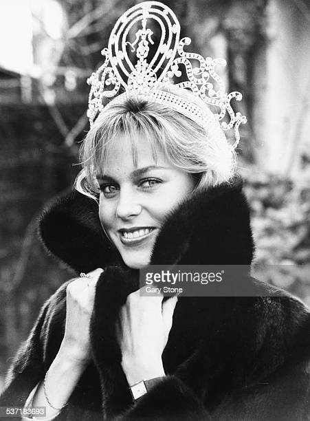 Portrait of Miss Universe, American winner Shawn Weatherly, wearing her crown and a fur coat, during a visit to London, December 5th 1980.