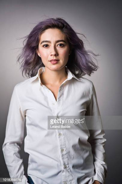 Portrait of Mixed Race Adult Female with Purple Hair