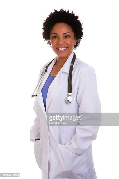 Portrait of mixed race female doctor with hands in pockets