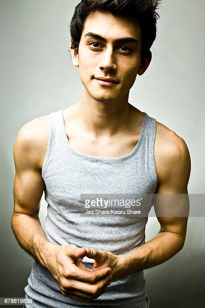 portrait of mixed race man wearing tank-top - black hair stock pictures, royalty-free photos & images