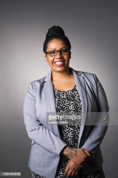 portrait of mixed race plus size african american business woman - plus size model stock pictures, royalty-free photos & images
