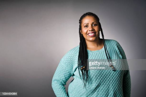 portrait of mixed race plus size african american woman - plus size model stock photos and pictures