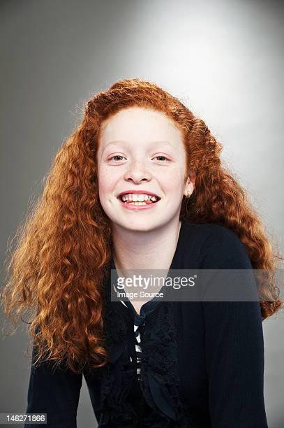 Portrait of mixed race teenage girl, studio shot